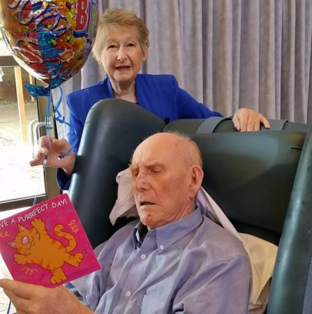Blue reading his 99th birthday card from his sister Betty